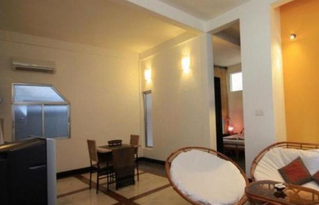 фотографии отеля Frangipani Villa-60s изображение №3